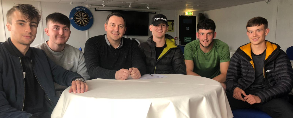FIRST TEAM ACADEMY GRADUATES SIGN UP